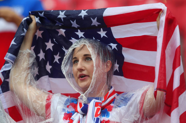 Image: A United States fan looks on in the rain prior to the 2014 FIFA World Cup Brazil group G match between the United States and Germany on Thursday in Recife, Brazil