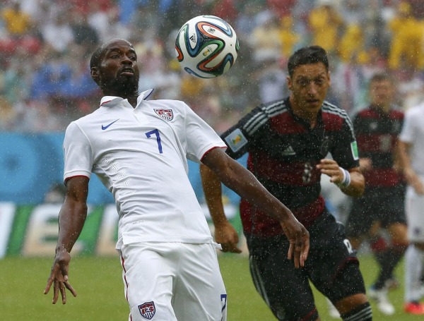 Image: Beasley of the U.S. fights for the ball with Germany's Ozil during their 2014 World Cup Group G soccer match at the Pernambuco arena in Recife