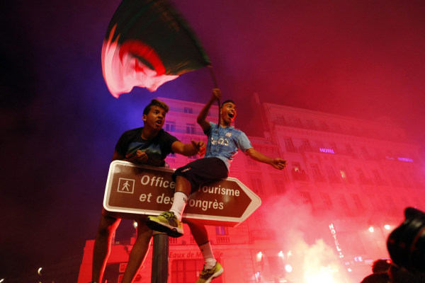 Image: Algerian soccer fans celebrate after their team qualified for the World Cup