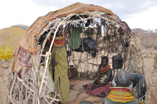 Image: These women of Marti village inside the manyatta are discussing the drought's devastation, Turkana in northern Kenya