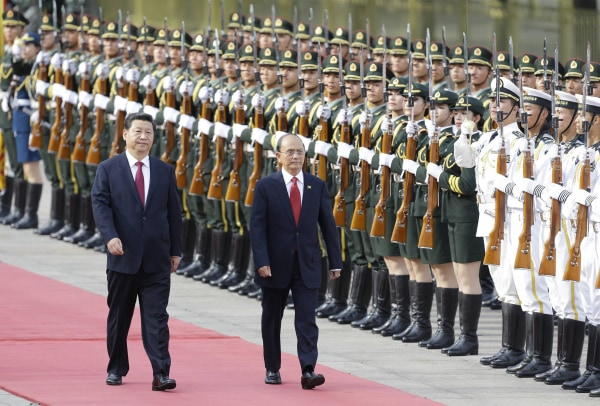Image: Myanmar's President Thein Sein and China's President Xi inspect honour guards in Beijing