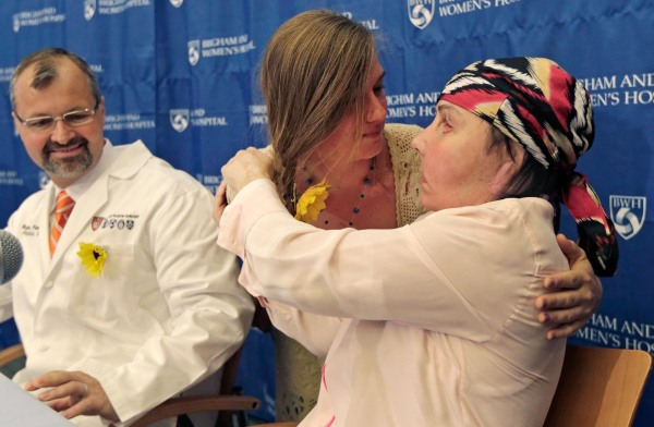 Image: Marinda Righter, center, embraces Carmen Blandin Tarleton