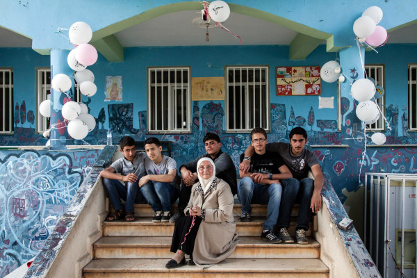 Image: Headmistress Hazar Mahayni sits on the steps of the Al Salam school in Reyhanli, Turkey.