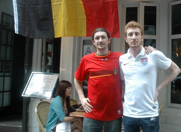 Image: Amael Feuillard and his brother, Uriell, pose outside the Belgian bar that Amael manages