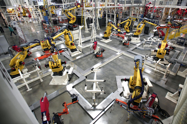 Image: Robots are shown on the assembly line of the new 2015 Chrysler 200 at the Sterling Heights Assembly Plant on March 14 in Sterling Heights, Mich.