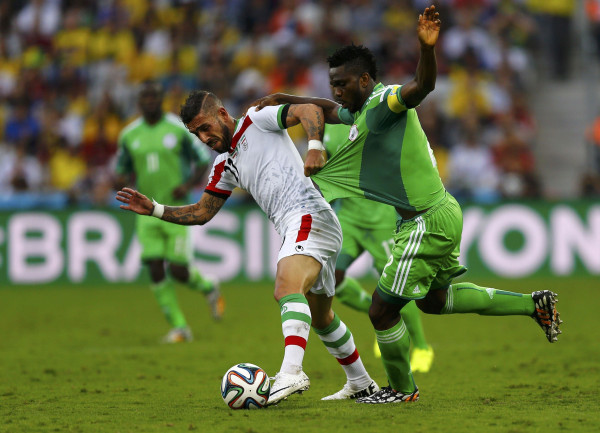 Image: Iran's Ashkan Dejagah fights for the ball with Nigeria's Joseph Yobo during their 2014 World Cup Group F soccer match at the Baixada arena