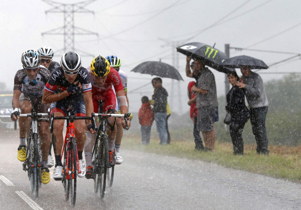 Image: A breakaway group of riders cycle during heavy rain falls during the 100 miles eighth stage of the Tour de France cycling race between Tomblaine and Gerardmer La Mauselaine
