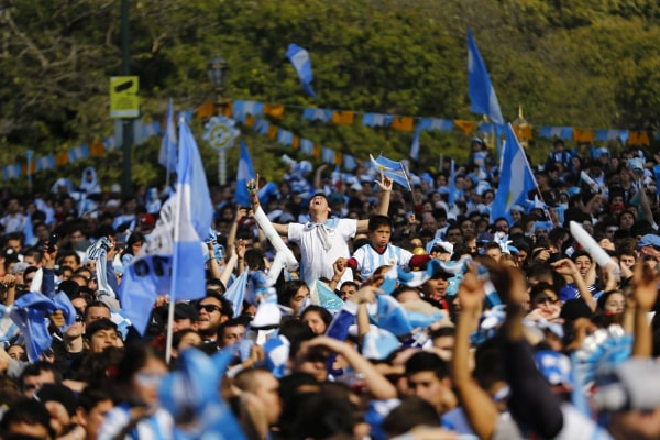 Image: Argentina's fans wait for the start of the 2014 World Cup final soccer match between Germany and Argentina at a public square viewing area in Buenos Aires