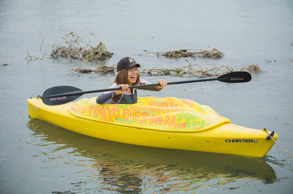 Image: Japanese artist Megumi Igarashi, known as Rokudenashiko, paddles in her kayak modeled on her vagina
