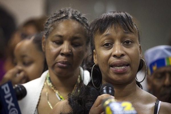 Image: Ellisha Flagg, sister of Eric Garner, speaks beside his wife Esaw Garner, left, during a service at the Mount Sinai Center for Community Enrichment for Eric Garner