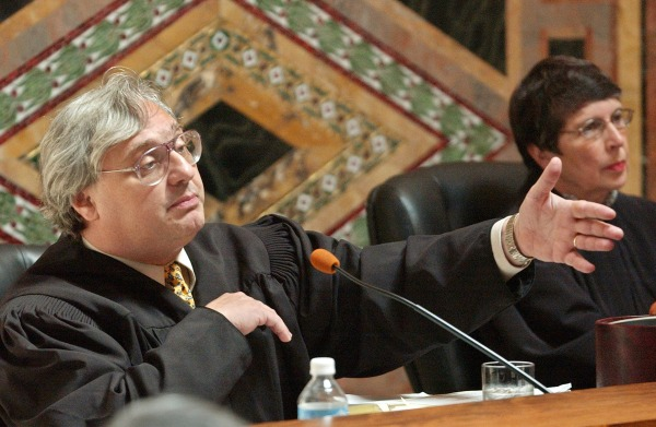 Image: Judge Alex Kozinski, of the 9th U.S. Circuit Court of Appeals, gestures as Chief Judge Mary Schroeder looks on in San Francisco on Sept. 22, 2003.