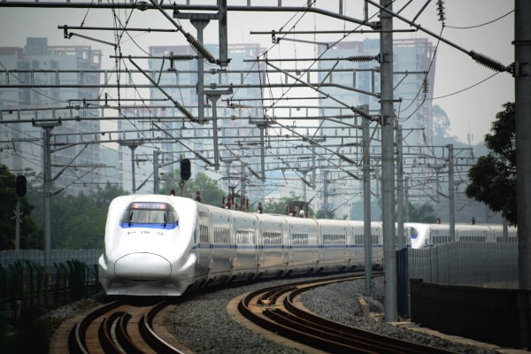 Image: A high-speed train travels on the railway to Beijing in Nanning, southern China's Guangxi province on June 13.