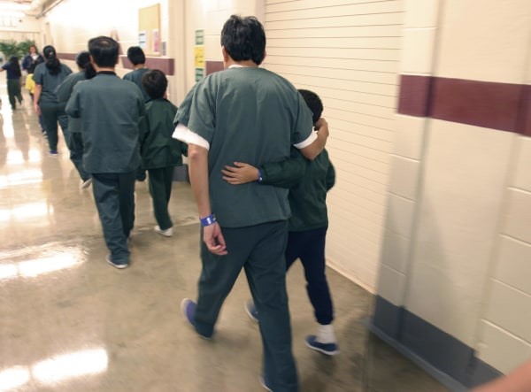 Image: Family detainees walking down the hall at the T. Don Hutto Residential Center in Taylor, Texas