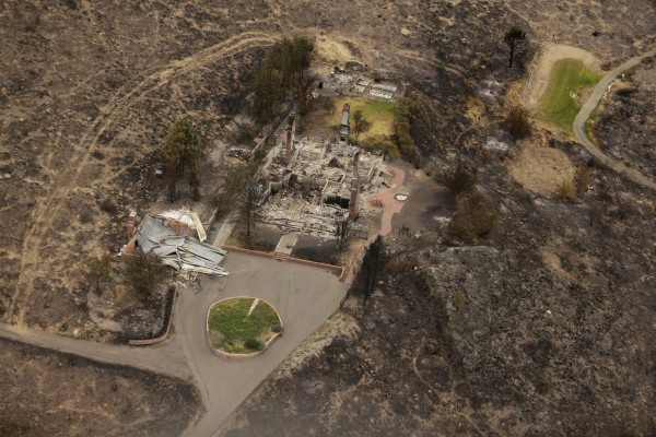 Image: Structures were destroyed by wildfires near Pateros, Wash.