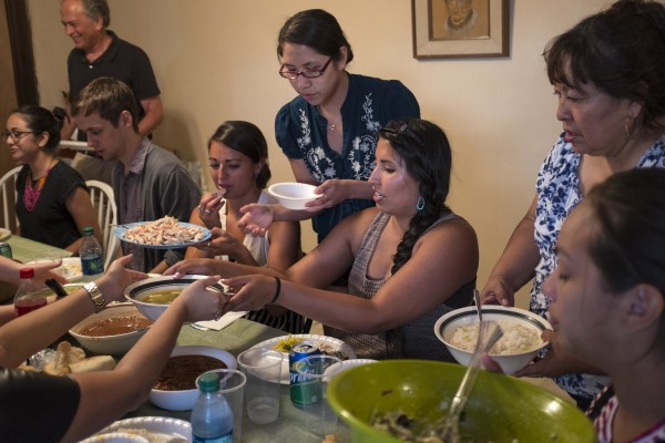 Image: Danielle Lucero, center, hosts Columbia University mentors at a feast at her family's traditional home.