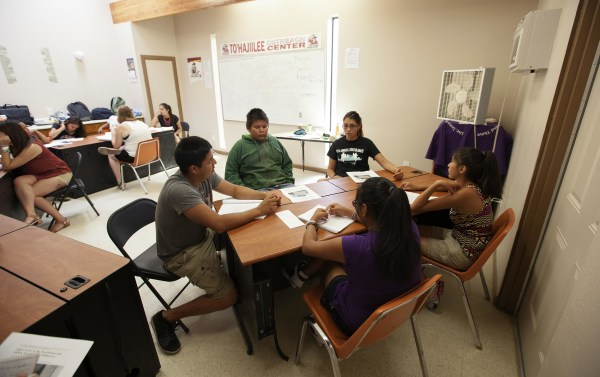 Image: Samantha Piaso, 16, right, participates in a session run by Columbia University students, including Christian White, left, and Fantasia Painter, center, trying to identify pervasive stereotypes of Native Americans during an AlterNATIVE mentoring se