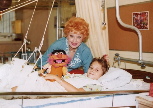 Image: Lucille Ball visits Tony Jacobsen, then 9, at Children's Hospital Los Angeles circa 1980