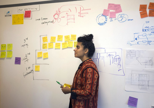 Image: Kiran Gandhi, the drummer for rapper MIA, works during a brainstorming session at Harvard Business School's Innovation Lab.
