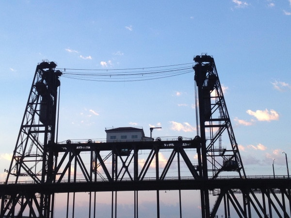 Image: Police arrested suspect Benjamin Lovitz for tight rope walking across the Steel bridge in Portland, Oregon