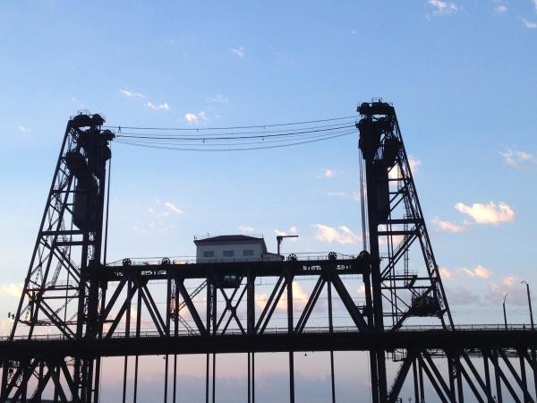 Image: Police arrested suspect Benjamin Lovitz for tight rope walking across the Steel bridge in Portland, Oregon