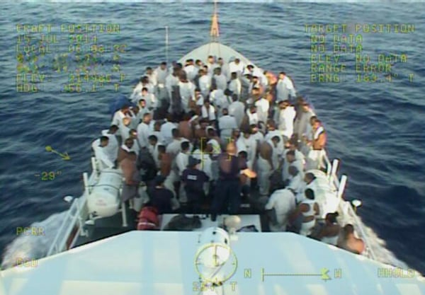 Image: 84 Cuban migrants stand on one of the Coast Guard's new Fast Response Cutters (FRC) in early July.