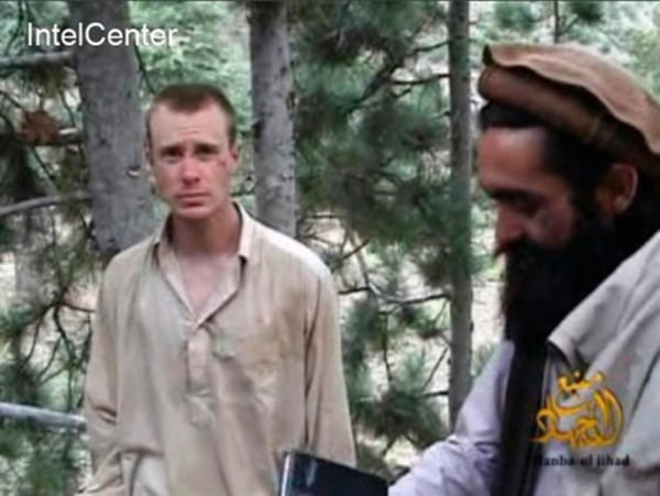 Image: Then-captured U.S. Army soldier Bowe Bergdahl (L) with a Taliban commander (R) in a video released by the Taliban in 2010.