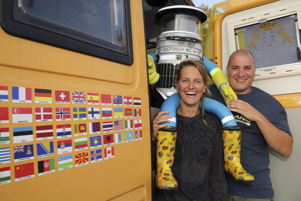 Image: HitchBOT is seen with Belgian tourists Kim Van Aerde and Seb Leeson in Sault Ste. Marie, Ontario