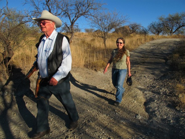 Image: Jim and Sue Chilton walk near the U.S. and Mexico border at the Chilton's ranch.