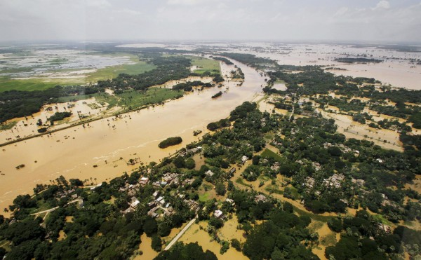 Image: An aerial view shows villages partially submerged by monsoon floods in Kendrapara district of eastern Orissa state, India
