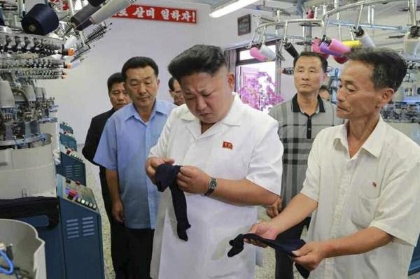 Image: North Korean leader Kim Jong-un visits a hosiery factory