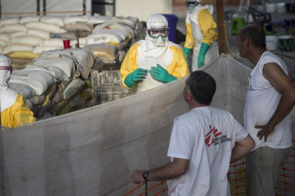 Image: The logistics team from Doctors Without Borders erects an incinerator in the Ebola isolation ward in Conakry, Guinea