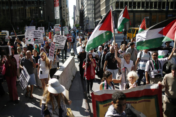 Image: Palestinians march during a protest in New York