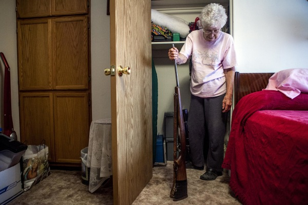 IMAGE: At her home in Nucla, Colo., historian Marie Templeton retrieves the gun her husband gave her for their second anniversary more than 60 years ago.
