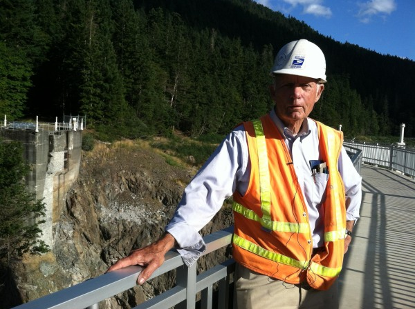 Image: Construction manager Don Laford stands on what remains of the Glines Canyon Dam.