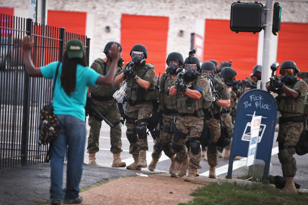Image: Police force protestrs from the business district into nearby neighborhoods on August 11, 2014 in Ferguson, Missouri
