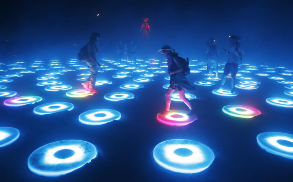 "Image: Participants interact with the art installation The Super Pool during a dust storm at the Burning Man 2014 ""Caravansary"" arts and music festival in the Black Rock Desert of Nevada"