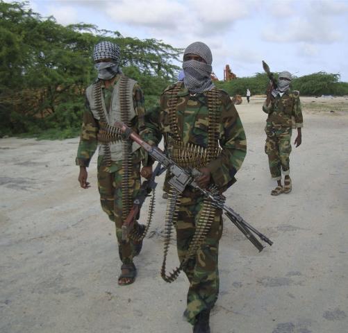 Image: Hard-line Islamist Al Shabab fighters conduct military exercise in northern Mogadishu's Suqaholaha neighborhood, Somalia