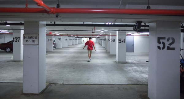 Image: Daniel Ogden, 14, walks through the parking garage in the apartment building where he lives with his adoptive family in Alexandria. Va. Christine and her husband Scott have seven children, four of whom they adopted.