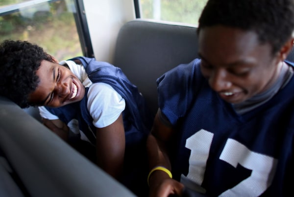 Image:  David Weathers (left,) a 17-year-old freshman at Williams College in Williamstown, MA, laughs with a football teammate