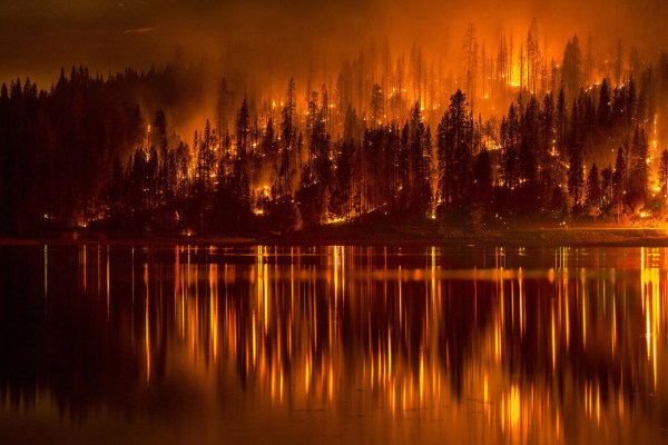 Image: A wildfire approaches the shores of Bass Lake, Calif. on Sept. 14.