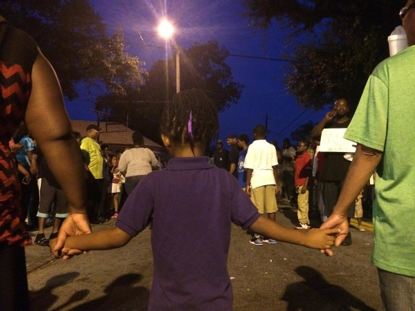 Image: The scene at a peaceful rally after an officer-invovled shooting in West Savannah, Ga.