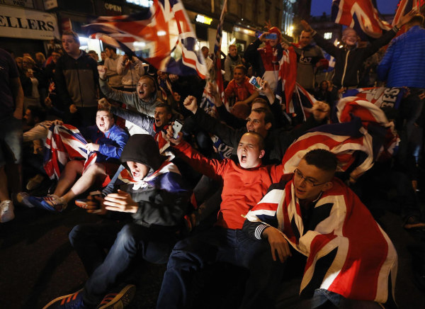 Image: Pro-union protestors chant and wave Union Flags during a demonstration at George Square in Glasgow