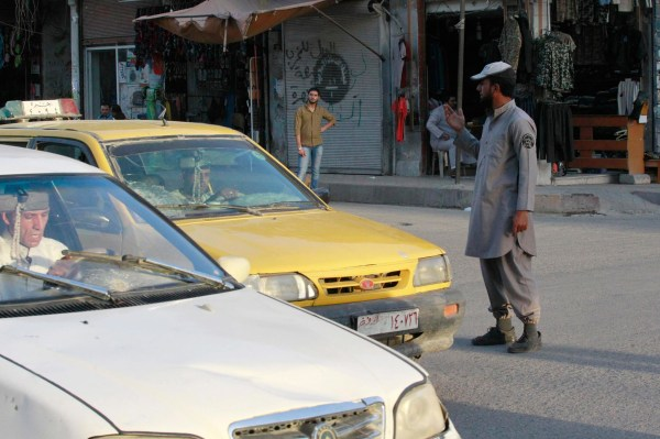 Image: An ISIS police officer directs traffic in Raqqa, Syria, on Sept. 18