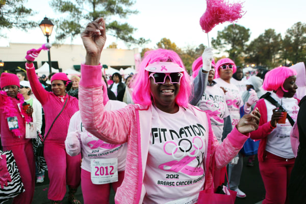 Image: A woman dances to warm up for the 20th Susan G. Komen Race for The Cure in Germantown, Tenn., on Oct. 27, 2012.