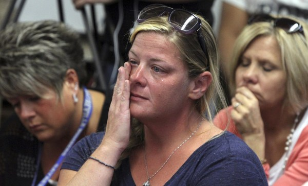 Image: Audience members react as members of the Sayreville Board of Education hold a news conference
