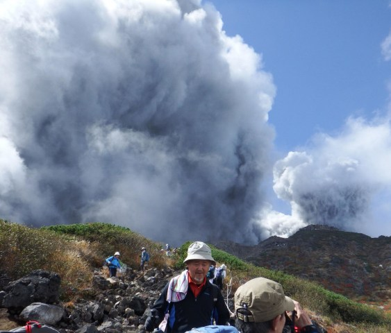 Image: Climbers descend Mt. Ontake, which straddles Nagano and Gifu prefectures, to evacuate as the volcano erupts in central Japan