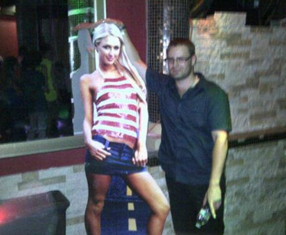 Image: Cameron LaCroix with a life-size cutout of Paris Hilton at a club in 2012.