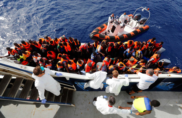 Image: Handout photo shows migrants boarding the Phoenix on Oct. 4