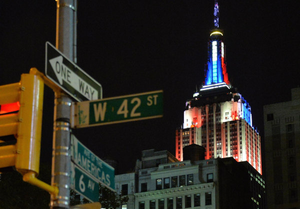 Image: Blue and red colors illuminate the Empire State Building, showing the preliminary polling results of the Senate race earlier in the evening.