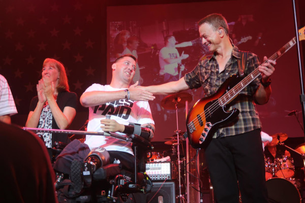 Image: Adam Keys and Gary Sinise on stage in Easton, Pa.
